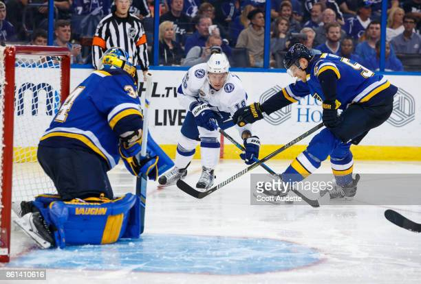 Ondrej Palat of the Tampa Bay Lightning skates against goalie Jake Allen and Colton Parayko of the St Louis Blues during the third period at Amalie...