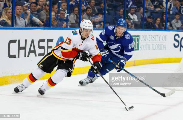 Ondrej Palat of the Tampa Bay Lightning skates against Johnny Gaudreau of the Calgary Flames during the third period at Amalie Arena on January 11...