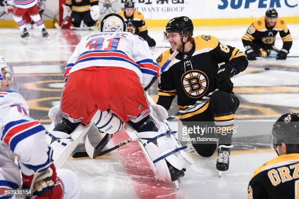 Ondrej Pavelec of the New York Rangers chats with David Pastrnak of the Boston Bruins before the game at the TD Garden on December 16 2017 in Boston...
