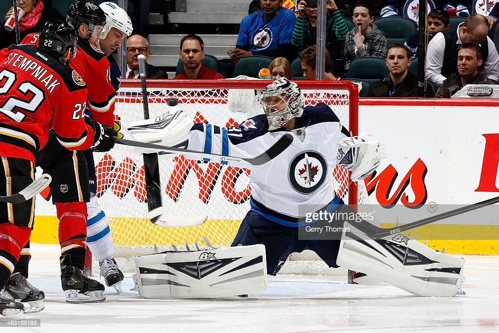 Ondrej Pavelec #31 of the Winnipeg Jets makes a blocker save against the Calgary Flames at Scotiabank Saddledome on January 16, 2013 in Calgary, Alberta, Canada.