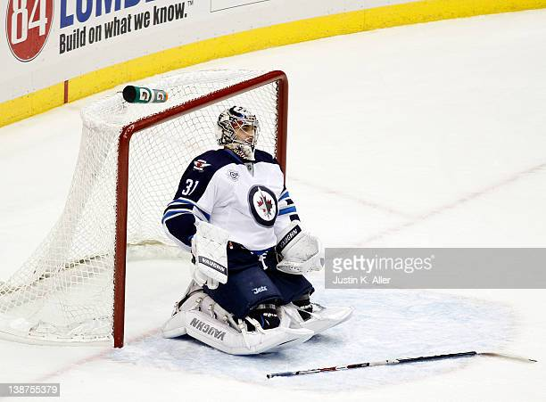Ondrej Pavelec of the Winnipeg Jets reacts after a goal by Evgeni Malkin of the Pittsburgh Penguins during the game at Consol Energy Center on...