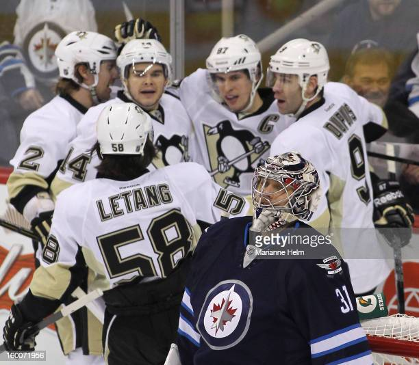 Ondrej Pavelec of the Winnipeg Jets reacts after a goal by Sidney Crosby of the Pittsburgh Penguins during firstperiod action on January 25 2013 at...