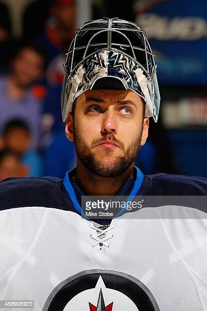 Ondrej Pavelec of the Winnipeg Jets skates against the New York Islanders at Nassau Veterans Memorial Coliseum on October 28, 2014 in Uniondale, New...