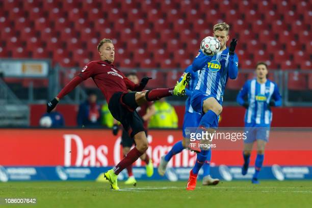 Ondrej Petrak of 1 FC Nuernberg and Arne Maier of Hertha BSC battle for the ball during the Bundesliga match between 1 FC Nuernberg and Hertha BSC at...