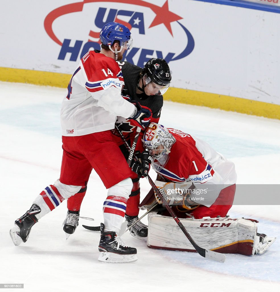 Ondrej Vala #14 of Czech Republic battles with Sam Steel #23 of Canada in front of goaltender Jakub Skarek #1 of Czech Republic during the third period of play in the IIHF World Junior Championships Semifinal game at KeyBank Center on January 4, 2018 in Buffalo, New York.