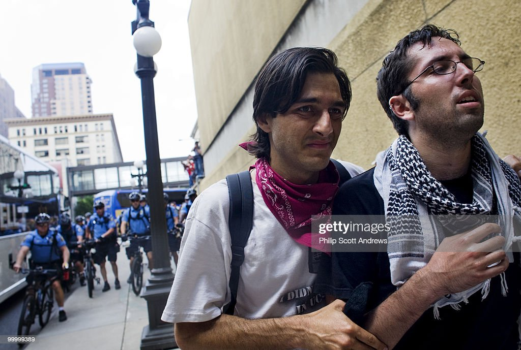 One activist helps another that was just maces by police officers away from the scene.