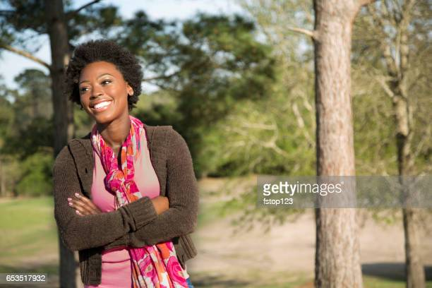 One African descent woman outdoors in park.