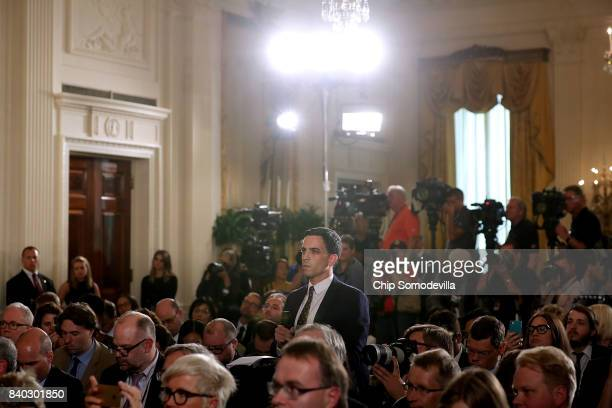 One America News Network Chief White House Correspondent John Yingst asks a question of US President Donald Trump during his joint news conference...