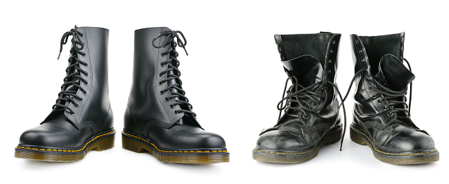 One and the same pair of black men's boots. New and worn out. 878662066