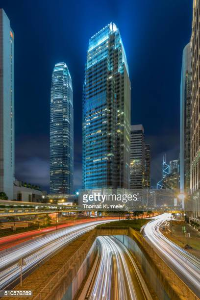 One and Two International Finance Centre at night with trail lights on highway, Hong Kong.