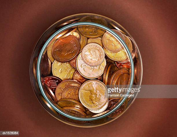 One and Two Pence Copins in a Glass Jar, Viewed From Directly Above