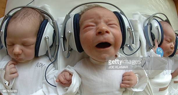One and Twodayold newborn babies listen to music with headphones at the 1st Private Hospital in eastern Slovak metropol of KosiceSaca 11 August 2005...