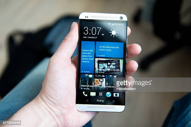 htc one – android phone with aluminum body - high tech computer corporation stock pictures, royalty-free photos & images