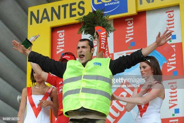 One antiairport protestor in the podium on July 7 2008 in Nantes at the end of the 208 km third stage of the 2008 Tour de France cycling race run...