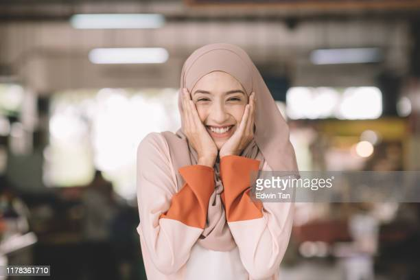 one asian muslim female headshot at wet market in the morning outdoor with positive emotion - beautiful ramadan stock pictures, royalty-free photos & images
