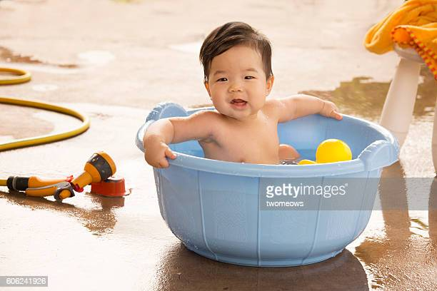 One asian toddler water play time.