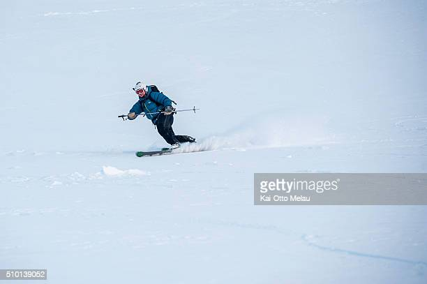 One athlete going down the mountain pass on February 13 2016 in Svolvar Norway The water temperature is around 4c and after the swimleg the athletes...