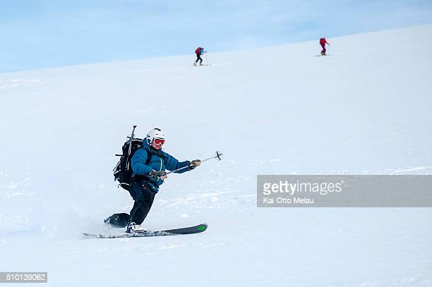 One athlete going down the mountain pass while others go up on February 13 2016 in Svolvar Norway The water temperature is around 4c and after the...