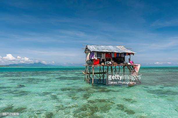 one bajau stilt house at semporna, sabah, malaysia - mabul island stock photos and pictures