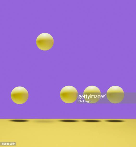 one ball bouncing higher than the others - comparison stock pictures, royalty-free photos & images