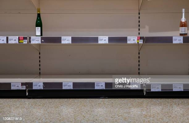 One bottle of Riesling wine and sparkling rose is left for sale on emptied shelves at a Sainsburys supermarket as the outbreak of coronavirus...