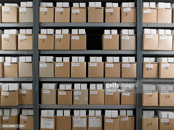 one box missing from rows of boxes on shelves - archive stock pictures, royalty-free photos & images