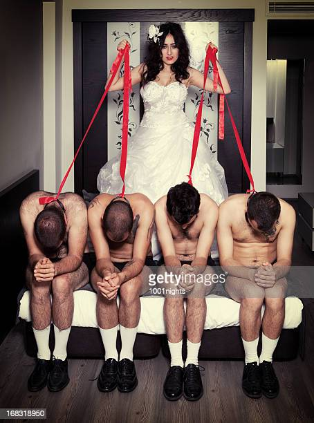 one bride four grooms - women tied to bed stock photos and pictures