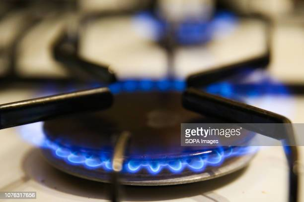 One burning ring is seen on a gas cooker A new energy price cap will come into force from 1 January 2019 saving 11 million customers an average of...