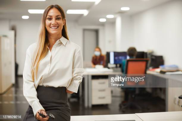 one business woman looking at camera. - persons with disabilities stock pictures, royalty-free photos & images
