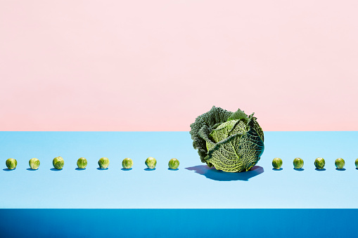 One cabbage in a row of sprouts - gettyimageskorea
