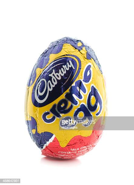 one cadbury creme egg on white background - cream stock pictures, royalty-free photos & images
