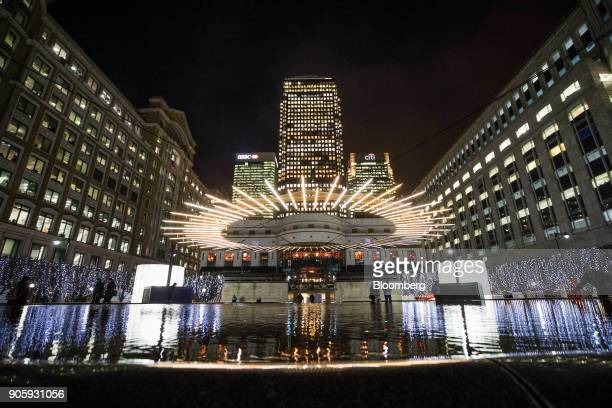 One Canada Square center the offices of HSBC Holdings Plc left and the offices of Citigroup Inc right stand during the Winter Lights festival at the...