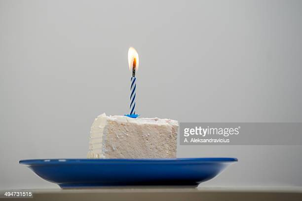 One candle on a cake piece