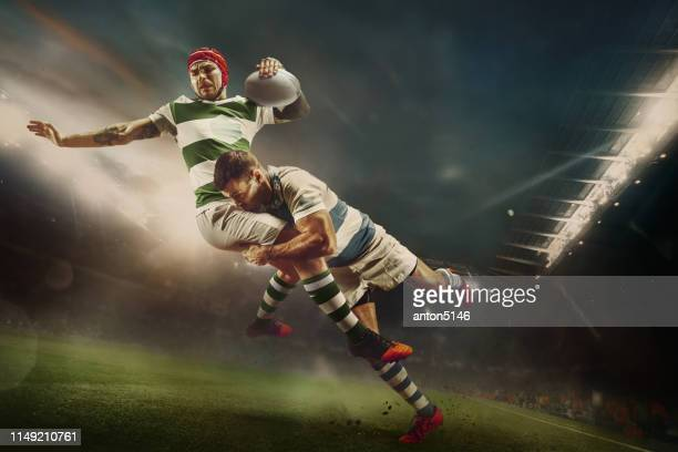 one caucasian rugby male player in action - rugby stock pictures, royalty-free photos & images