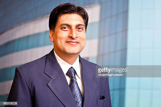 One Cheerful Indian Businessman in Front of Office Building