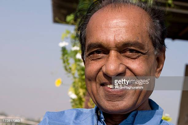 one cheerful indian senior citizen male man smiling horizontal outdoor - bangladeshi man stock photos and pictures