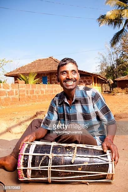 one cheerful rural indian man with a traditional music instrument - indian music stock photos and pictures