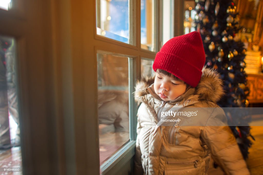 One Child Looking Unhappy In Front Glass Door Stock Photo Getty Images