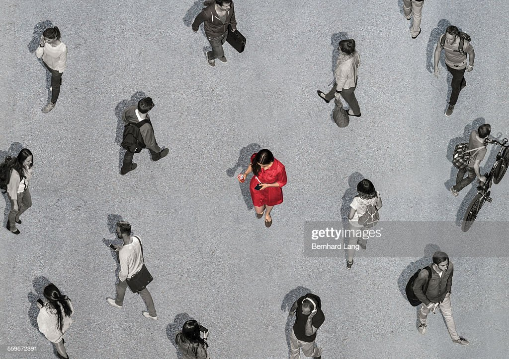 One colored woman among colorless people : Stock Photo
