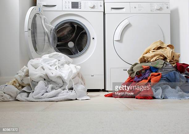 one coloured one white pile of washing - heap stock pictures, royalty-free photos & images