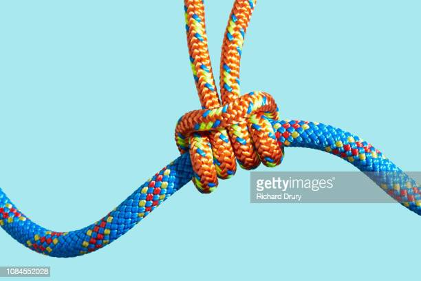 One coloured rope supporting a larger rope