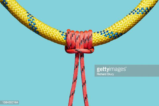 One coloured rope tied to a larger rope