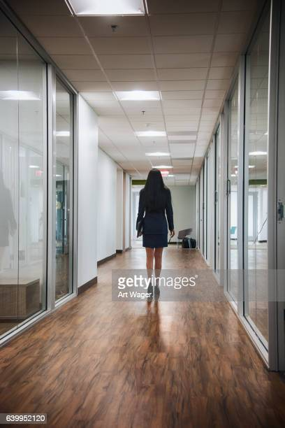 One Confident Businesswoman Walking Alone Through the Office