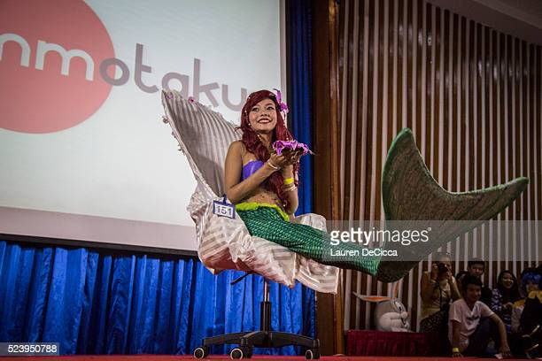 One cosplayer dressed as Ariel from Disney's 'The Little Mermaid' on April 24 2016 in Yangon Burma Hundreds of youths between 16 to 24 gathered at...