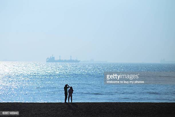One couple's silhouette on the beach