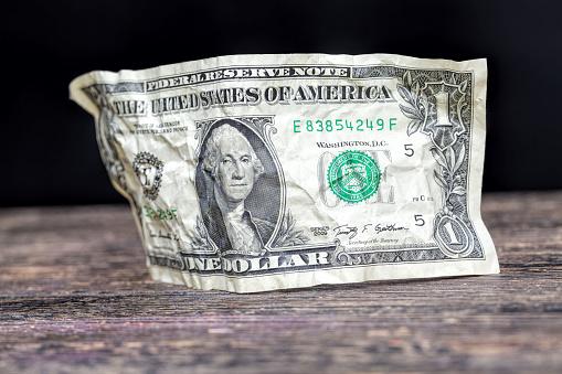 one crumpled American dollars 1266122146