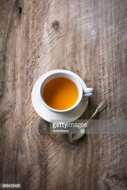 one cup of black tea on rustic wooden table top. - black tea stock pictures, royalty-free photos & images