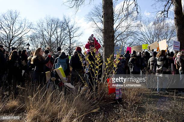 One day after President Trump signed an executive order barring immigration from seven muslim nations a large crowd of New Yorkers gather for a...