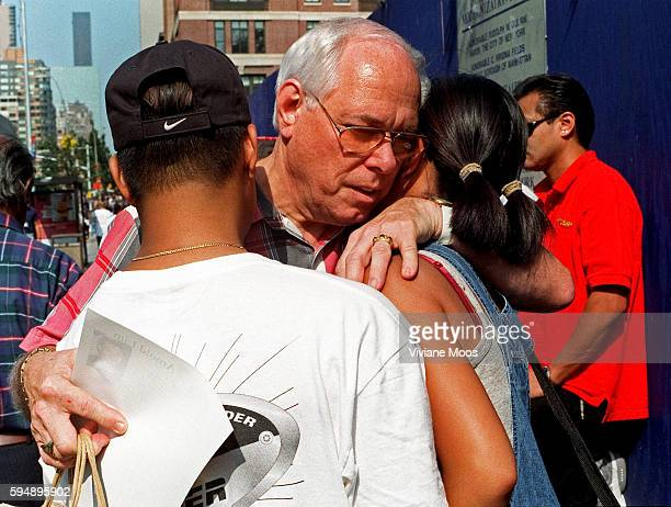 One day after terrorist attack the World Trade Center a young Asian couple is comforted by a passing Reverend as they fear for and mourn her missing...