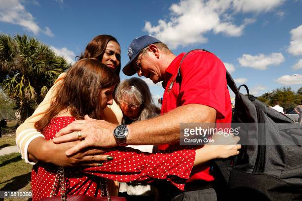 One day after the deadly shooting at Marjorie Stonemason Douglas High School in Parkland Florida that left 17 dead and 14 injured people gather after...